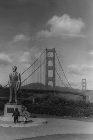 APRIL 8, 1962: Engineer, dreamer, and poet, Joseph Strauss stands enshrined in bronze at south end of his towering Golden gate Bridge San Francisco. On May 27 span celebrates 25th anniversary of its opening in 1937. More than two million vehicles use it each month, passing between San Francisco and the northern Redwood Empire counties.