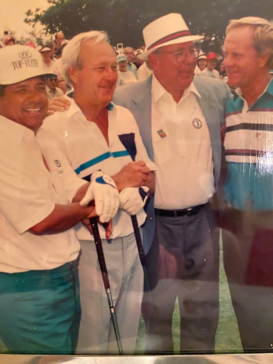 Burch Riber, center, with golf legends Jack Nicklaus, right, Arnold Palmer, left, and Lee Trevino, far left.