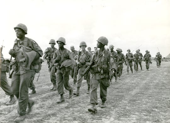 Then-Staff Sgt. Sidney Brown leads a platoon of C Co., 2/502 Infantry, 101st Airborne Division to waiting helicopters prior to an operation in Tuy Hoa, Vietnam in 1965.
