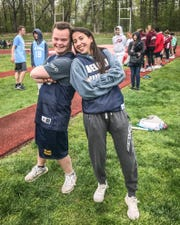 Del Val Unified Track teammates Jeff Bill and Karla Jenkins strike a pose at a meet last spring.