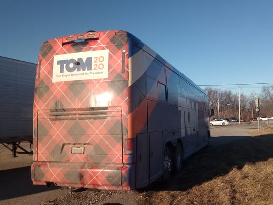 Tom Steyer's bus sits parked outside La Carreta Mexican Grill in Marshalltown on Sunday afternoon. The blue bus includes patches of red flannel on the front and back, the design of Steyer's signature ties.