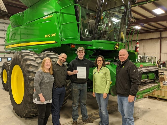 Pictured with Eric Snyder (center) are his parents Nikki and Steve Synder on the left,Madrid Location Service Manager Jennifer Heflebower, and Madrid Location ManagerMatt Harney on the right.
