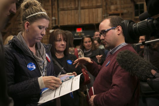 Precinct leaders count votes during the Democratic presidential caucus at Simpson Barn in Johnston in 2016.