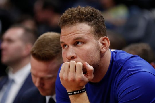 Detroit Pistons forward Blake Griffin sits on the bench against the Utah Jazz, Dec. 30, 2019 in Salt Lake City, Utah.