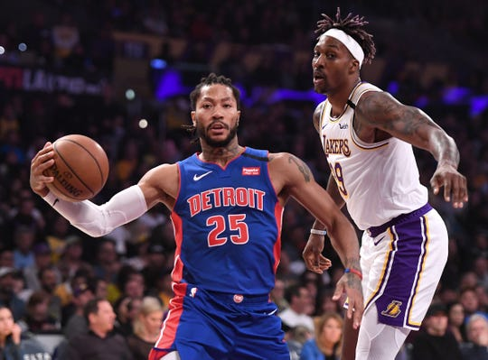 Detroit Pistons guard Derrick Rose drives to the basket against Los Angeles Lakers center Dwight Howard in the first half at Staples Center, Jan. 5, 2020.