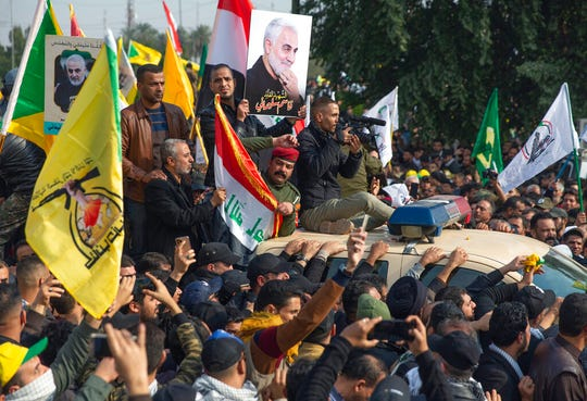 Mourners march during the funeral of Iran's top general Qassem Soleimani, and Abu Mahdi al-Muhandis, deputy commander of Iran-backed militias in Iraq known as the Popular Mobilization Forces, in Baghdad, Iraq, Saturday.