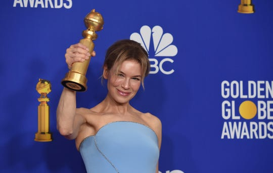 Renee Zellweger poses in the press room with the award for best performance by an actress in a motion picture drama for 'Judy.'