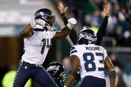 Seattle Seahawks' D.K. Metcalf, left, and David Moore celebrate after Metcalf's touchdown catch during the second half.