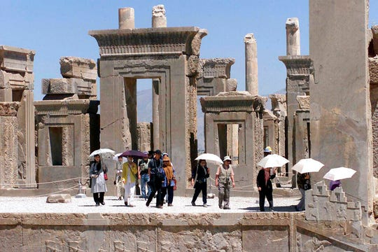 In this May 22, 2002 file photo, a group of Japanese tourists visit Persepolis, a UNESCO World Heritage Site, northeast of the Iranian city of Shiraz.