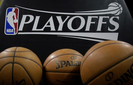 A logo for the NBA playoffs and official basketballs are seen on the court prior to Game 1 of an NBA basketball playoffs basketball game between the Los Angeles Lakers and San Antonio Spurs, Sunday, April 21, 2013, in San Antonio, Texas.