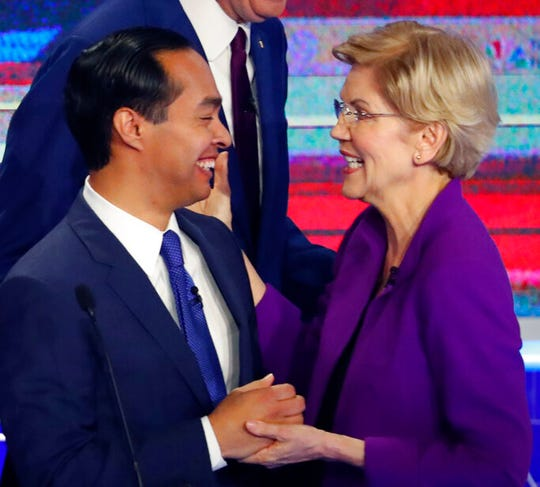"""In this June 26, 2019 file photo, Democratic presidential candidates Sen. Elizabeth Warren, D-Mass., and former Housing and Urban Development Secretary Julian Castro share a moment at the end of a Democratic primary debate hosted by NBC News. Castro is endorsing Warren, saying the Massachusetts senator is """"the most qualified, best-equipped candidate to win the nomination."""""""