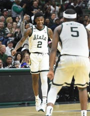 Rocket Watts celebrates a late 3-pointer with Cassius Winston as Michigan State defeats Michigan on Sunday.