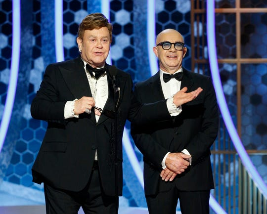 This image released by NBC shows presenters Elton John, left, and Bernie Taupin at the 77th Annual Golden Globe Awards at the Beverly Hilton Hotel in Beverly Hills, Calif., on Sunday, Jan. 5, 2020.