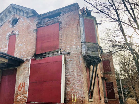 This boarded-up, sagging home at 64 Edmund Place is the 47th empty Detroit building linked to the Ilitch organization, according to public records. The home is in the Brush Park neighborhood on the northern edge of downtown.