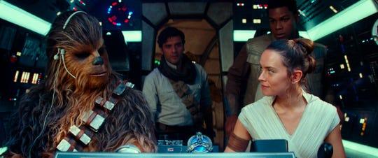 "Joonas Suotamo as Chewbacca, left, Oscar Isaac as Poe Dameron, Daisy Ridley as Rey and John Boyega as Finn in a scene from ""Star Wars: The Rise of Skywalker."""