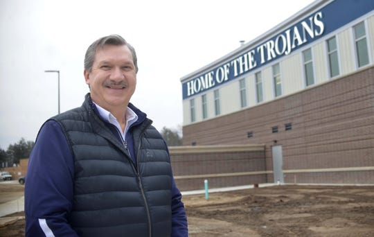 """Superintendent Bob Szymoniak talks about features at the new Fruitport High School building, which features curved hallways, protective """"wing walls,"""" impact-resistant windows and doors that lock with the touch of a smartphone to thwart an active shooter."""