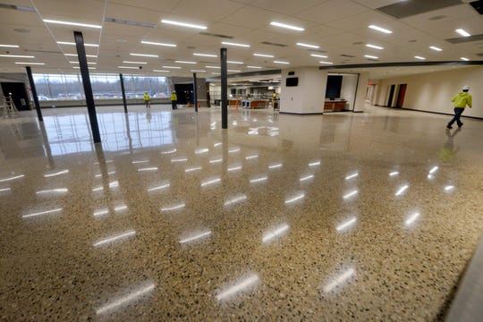 """The high school has curved hallways, protective """"wing walls,"""" impact-resistant windows and doors that lock with a touch of a smartphone designed to potentially save lives in an active shooter situation."""