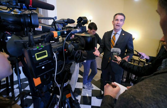 Gov. Ralph Northam speaks to members of the media after a press conference at the State Capitol Monday, Jan. 6, 2020 where he previewed his voting legislative proposals, including removing Lee-Jackson Day as a state holiday and replacing it with election day.