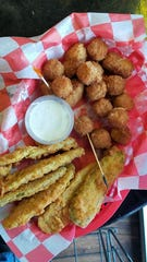 hand-breaded dill pickle strips and cheese balls at Piston's Bar and Grill.