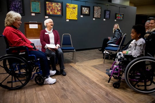 Sandy Ford, left, and Ellie-Jane Pfingston, right, are introduced as Easterseals 2020 ambassadors at the Easterseals Early Learning Center Monday afternoon, Jan. 6, 2019.