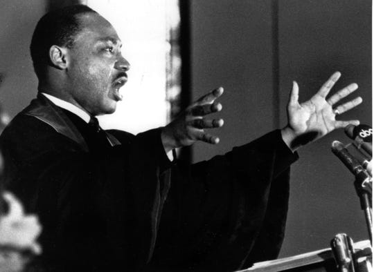 """The Rev. Dr. Martin Luther King Jr. gestures to his congregation in Ebenezer Baptist Church in Atlanta, Ga. on April 30, 1967 as he urges America to repent and abandon what he called its """"Tragic, reckless adventure in Vietnam."""" January 19 is the federal holiday commemorating King's birthday."""