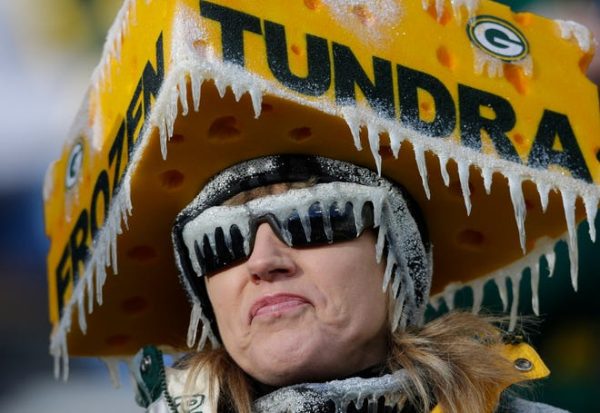 A fan embraces the cold before the start of the Packers-Titans game on Dec. 23, 2012, at Lambeau Field in Green Bay.