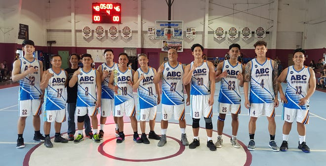 ABC Stores captured the championship title with Shawn Biven #23 making the buzzer beater layup for 48-46 victory against Team Tatuha in the 2019 Holiday TipOFF day of champions on Saturday at Tamuning Gym. ABC's Russel Manabat #13 was named MVP and teammate Lennel Manalo #4 received the top scorer award. Standing left to right are Rico Gaerlin, Gedi Rivera, Aaron Uson, John Oqueno, Jay Laxamana, Richard Bocago, Dominic Reyes, Harold Guelan, Shawn Biven, Lennel Manalo and Russel Manabat. Visit www.guambasketball.com for official results.