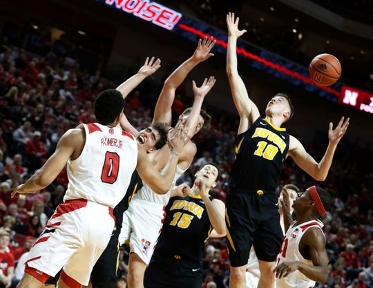 Iowa players Joe Wieskamp (10), Luka Garza (left) and Ryan Kriener (background) are winless in Pinnacle Bank Arena. The Hawkeyes have lost three in a row there, usually in heartbreaking fashion.