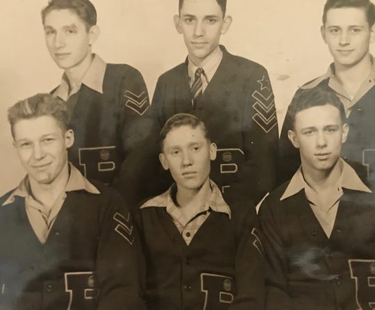 Keith Dougherty (bottom right) shown with his senior class of boys at Pimento High.