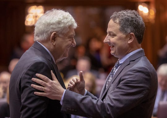 Ed Soliday (left), speaks with fellow Indiana House Republican Todd Huston, on the first day of the Indiana legislative session, Indiana Statehouse, Indianapolis, Monday, Jan. 6, 2020.