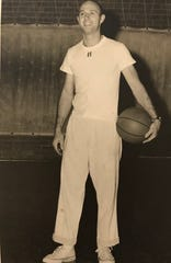 Keith Dougherty is shown as head coach at Hymera High in the 1950s.