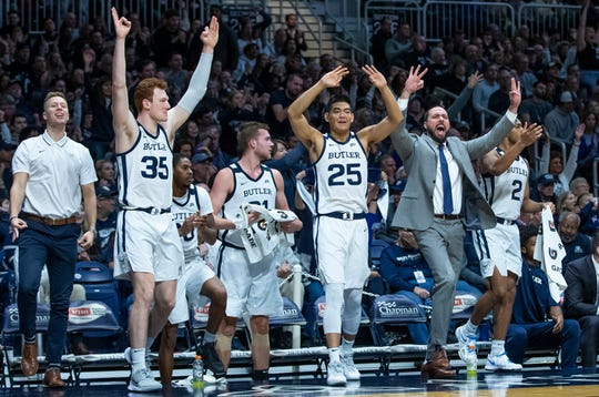 The Butler Bulldogs bench erupts after a three point make by guard Kamar Baldwin (3) against the Creighton Bluejays at Hinkle Fieldhouse on Jan. 4.