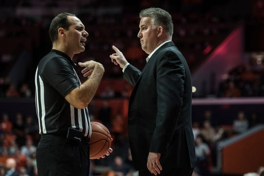Purdue Head Coach Matt Painter makes a point with an official as Purdue takes on Illinois in the first half of an NCAA college basketball game, Sunday, Jan. 5, 2020, in Champaign, Ill. (AP Photo/Holly Hart)