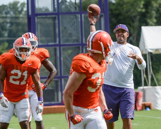 Aug 8, 2018; Clemson, SC, USA; Clemson Tigers co-offensive coordinator Tony Elliott throws to wide receiver Ryan Mac Lain (37) during fall practice at Clemson University. Mandatory Credit: Ken Ruinard/Anderson Independent Mail via USA TODAY NETWORK