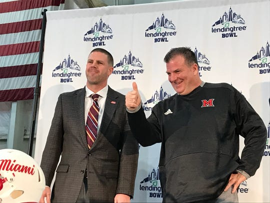 UL coach Billy Napier, left, and Miami (Ohio) coach Chuck Martin meet before Monday night's LendingTree Bowl in Mobile.