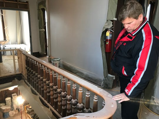 Fairfield County facilities supervisor Dennis Keller examines an original banister in the Beery House at High and Main streets. The county is moving the auditor's real estate department into the building, which is about 85% renovated now.