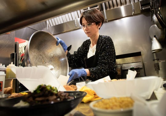 Linh Lee, owner of Capital City BBQ in Lansing, works Monday, Jan. 6, 2020, during a larger-than-normal lunch rush.