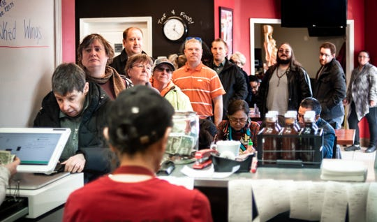Customers line up at Capital City BBQ in Lansing on Monday, Jan. 6, 2020, during a larger-than-normal lunch rush.
