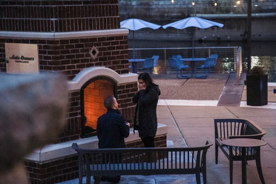 Ben Wood surprises his longtime girlfriend, Mara Porritt, with a marriage proposal Dec. 14, 2019 at Lansing's new riverfront park, Rotary Park.