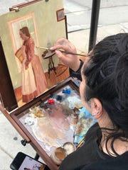 Art Slam Challenge Artist Sonia Vasquez working on her Ron Stokes People's Choice Award winning painting.
