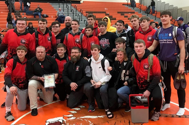Coach Steve Haverdill (second from left, first row) and his Crestview Cougars celebrate finishing runner-up in the 58th J.C. Gorman Invitational. Caden Hill (far left, back row) won the heavyweight title and Hayden Kuhn (white hoodie) was runner-up at 113 pounds.