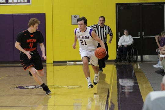 Lexington's Dylan Spears dribbles up the court during a loss to Upper Sandusky last week.