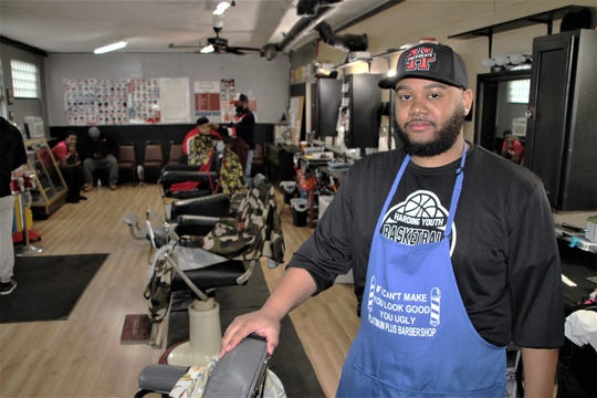 Daveon McGary, owner of Platinum Plus Barber Shop and Salon at 134 London St. in Marion, said friends and clients flooded his cellphone and social media with messages immediately after Gov. Mike DeWine's order Wednesday that closed all barber shops, salons, spas, and tattoo parlors in Ohio. Andrew Carter/Marion Star