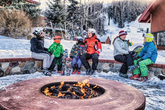 Lutsen Mountains in Minnesota has an outdoor fire pit for warming up around after skiing