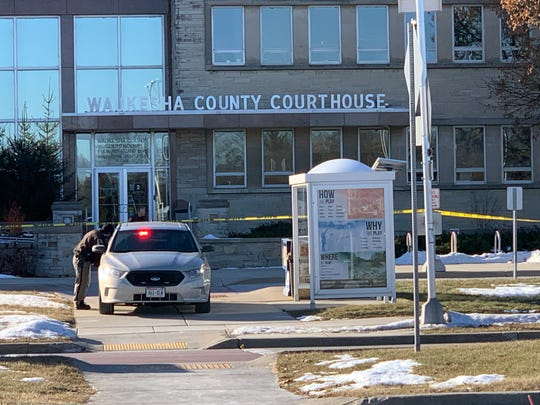 A safety vehicle blocks the sidewalk entrance to the Waukesha County Courthouse following a 9 a.m. bomb threat that forced the evacuation of the campus on Monday, Jan. 6, 2019.