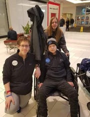 Mikey Choroszy, front right, is at Mall of America with his siblings Ryan, left, and Rachel, back, Dec. 31 for his Make-A-Wish trip. Mikey had brain cancer and died the next day.