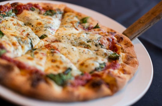 Pizza is one of the mainstays at Divino, 2315 N. Murray Ave. It's also to be served at the new restaurant opening there, called Tavolino. Divino is open through Jan. 31.