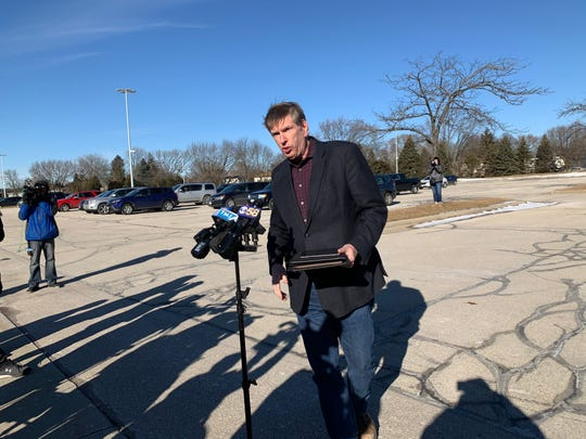 Sheriff Eric Severson speaks to reporters in the parking lot directly across from the Waukesha County Courthouse after the building was evacuated Monday, Jan. 6, 2019, due to a bomb threat.