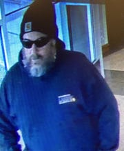 The Waukesha County Sheriff's Office on Jan. 6 released a photo of this unidentified man and listed him as a person of interest in a bomb threat made at the county courthouse and administration buildings. The sheriff's department said Monday evening it has arrested a suspect linked to the threat.