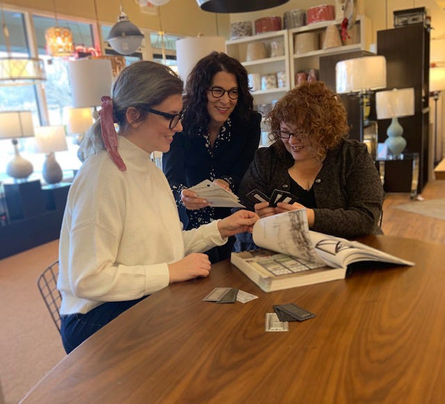 Donna Johnson, owner of Brookfield lighting retailer Filament, works in the store with employees Abby Heller (left) and Kimberly Mackowski (right). Filament is closing after more than 45 years in business.